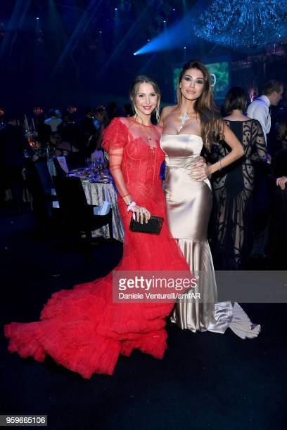 Sophie Hermann and guest attend the amfAR Gala Cannes 2018 dinner at Hotel du CapEdenRoc on May 17 2018 in Cap d'Antibes France