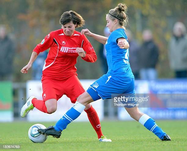Sophie Howard of Hoffenheim battles for the ball with Nicole Loipersberger of Sindelfingen during the Womens Second Bundesliga match between TSG 1899...