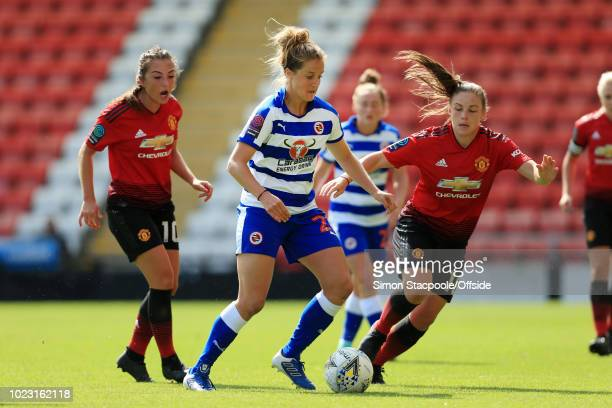 Sophie Howard of Reading battles with Kirsty Hanson of Man Utd during the FA WSL Continental Tyres Cup match between Manchester United Women and...