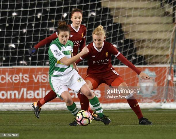 Sophie Ingle of Liverpool Ladies competes with AnnMarie Heatherson of Yeovil Town Ladiesbg during the FA Women's Super League match between Liverpool...