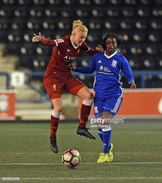 Sophie Ingle of Liverpool with Freda Ayisi of Birmingham in action during the WSL match between Liverpool Ladies and Birmingham City Ladies at Select...