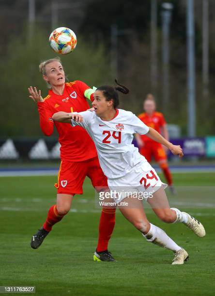Sophie Ingle of Wales and Evelyn Viens of Canada contest the ball during the Women's International Friendly match between Wales and Canada at...
