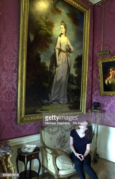 Sophie Jepson from British Heritage inspects a painting by Joshua Reynolds titled Emilia Countess of Bellamont on display at the Wernher Collectiona...