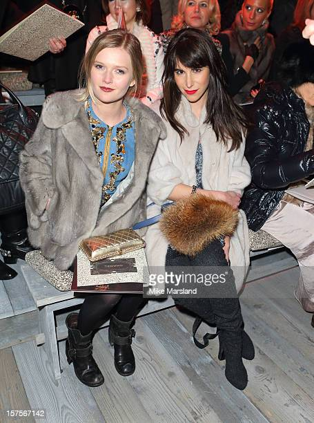 Sophie KennedyClark and Caroline Sieber attend the CHANEL Metiers d'Art fashion show at Linlithgow Palace on December 4 2012 in Linlithgow Scotland