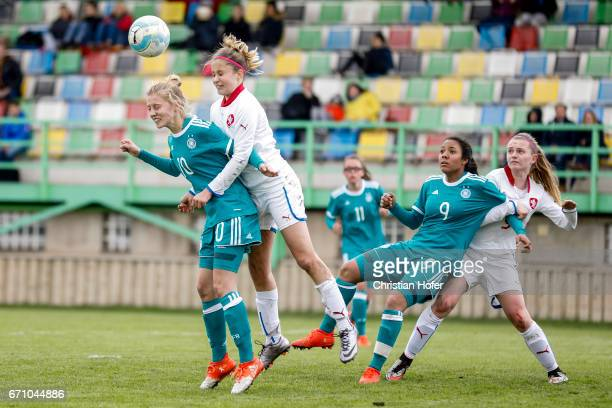 Sophie Krall and Gia Corley of Germany compete for the ball in the air with Aneta Sovakova and Aneta Buryanova of Czech Republic during the Under 15...