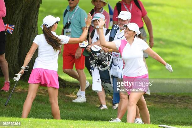 Sophie Lamb and Olivia Mehaffey of Great Britian & Ireland celebrate on the 17th hole during four-ball matches on day one of the 2018 Curtis Cup at...