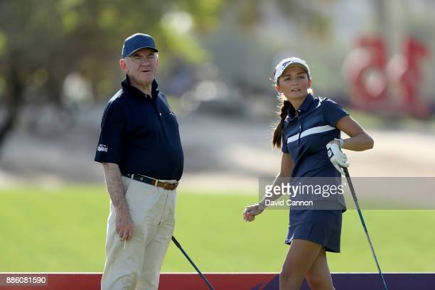 Sophie Lamb of England the young amateur follows her tee shot watched by Peter Dawson the Chairman of the Omega Dubai Ladies Classic during the proam...
