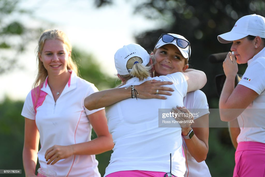Sophie Lamb of Great Britian & Ireland hugs captain Elaine Farquharson-Black during foursomes matches on day one of the 2018 Curtis Cup at Quaker Ridge Golf Club on June 8, 2018 in Scarsdale, New York.