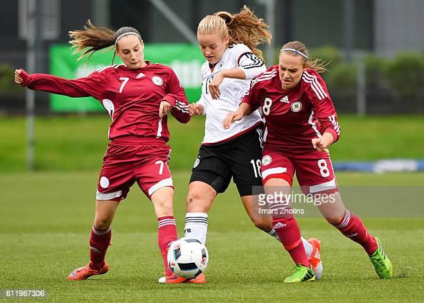 Sophie Lena of Germany is challenged by Valerija Gudkova and Viktorija Zaicikova of Latvia during the UEFA Under17 Girl's Euro Qualifier match...