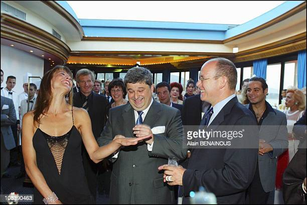 Sophie Marceau guest of honor Chaumet's CEO Thierry Frietch and prince Albert of Monaco on August 02 2003