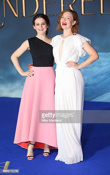 Sophie McShera and Holliday Grainger attend the UK Premiere of Cinderella at Odeon Leicester Square on March 19 2015 in London England