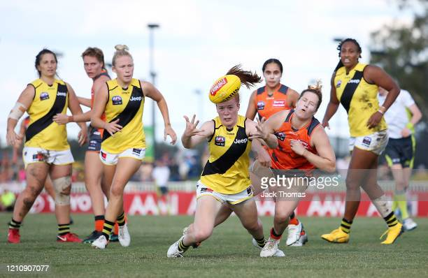 Sophie Molan of the Richmond Tigers fumbles the ball under pressure from Brittany Tully of GWS Giants during the round five AFLW match between the...