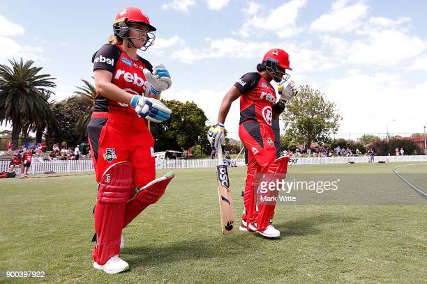 Sophie Molineux and Chamari Atapattu of Melbourne Renegades walk onto the field to bat during the Women's Big Bash League match between the Sydney...