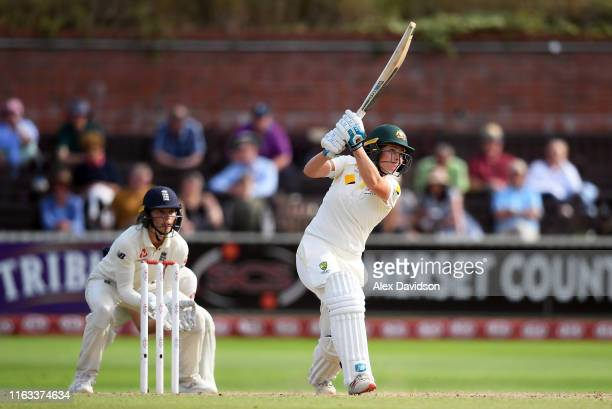 Sophie Molineux of Australia bats watched on by Amy Jones of England during Day Four of the Kia Women's Test Match between England Women and...