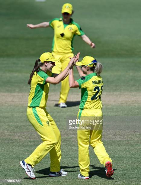 Sophie Molineux of Australia celebrates with team mate Annabel Sutherland after taking the wicket of Sophie Divine of New Zealand during game three...