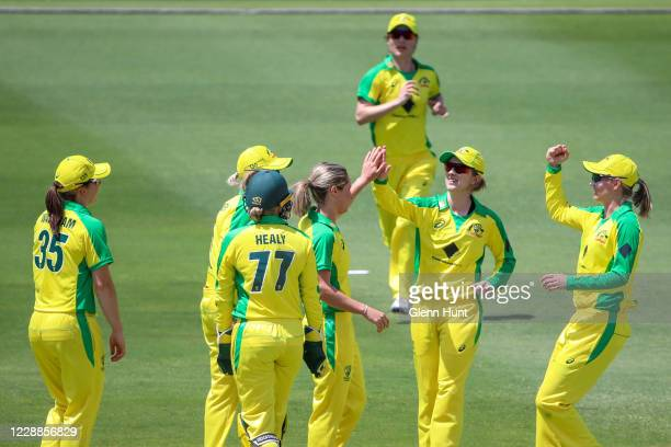 Sophie Molineux of the Australia celebrates with team mates after getting the wicket of Katey Martin of New Zealand during game one in the women's...
