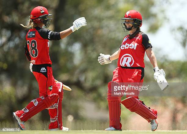 Sophie Molineux of the Renegades and Danni Wyat of the Renegades celebrate victory during the Women's Big Bash League match between the Melbourne...