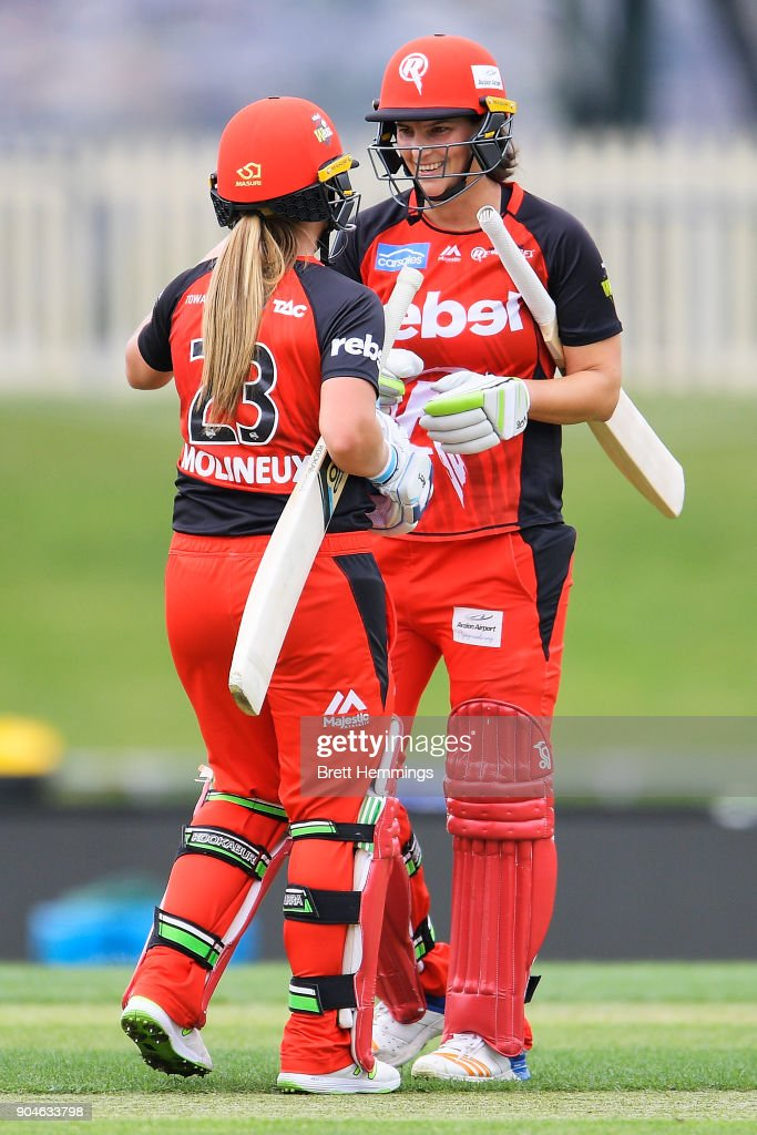 Sophie Molineux of the Renegades and Emma Inglis of the Renegades celebrate victory during the Women's Big Bash League match between the Melbourne Renegades and the Hobart Hurricanes at Blundstpne Arena on January 14, 2018 in Hobart, Australia.