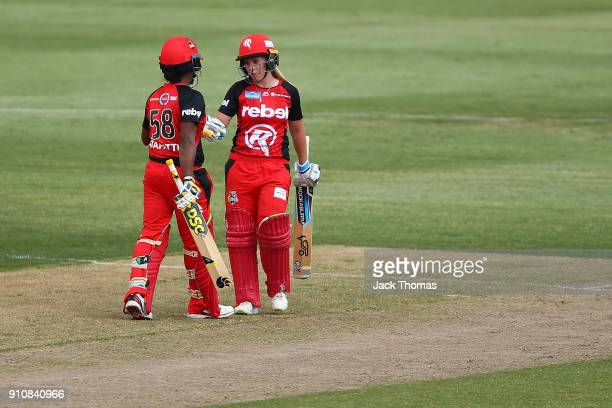 Sophie Molineux of the Renegades celebrates making 50 runs with teams mate Chamari Atapattu of the Renegades during the Women's Big Bash League match...