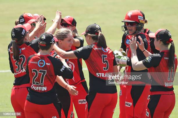 Sophie Molineux of the Renegades is congratulated by her teammates after dismissing Smriti Mandhana of the Hurricanes bats during the Women's Big...