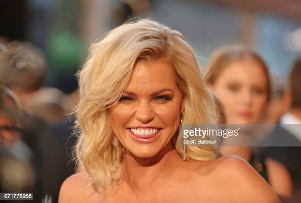 Sophie Monk winks at the camera as she arrives at the 59th Annual Logie Awards at Crown Palladium on April 23 2017 in Melbourne Australia