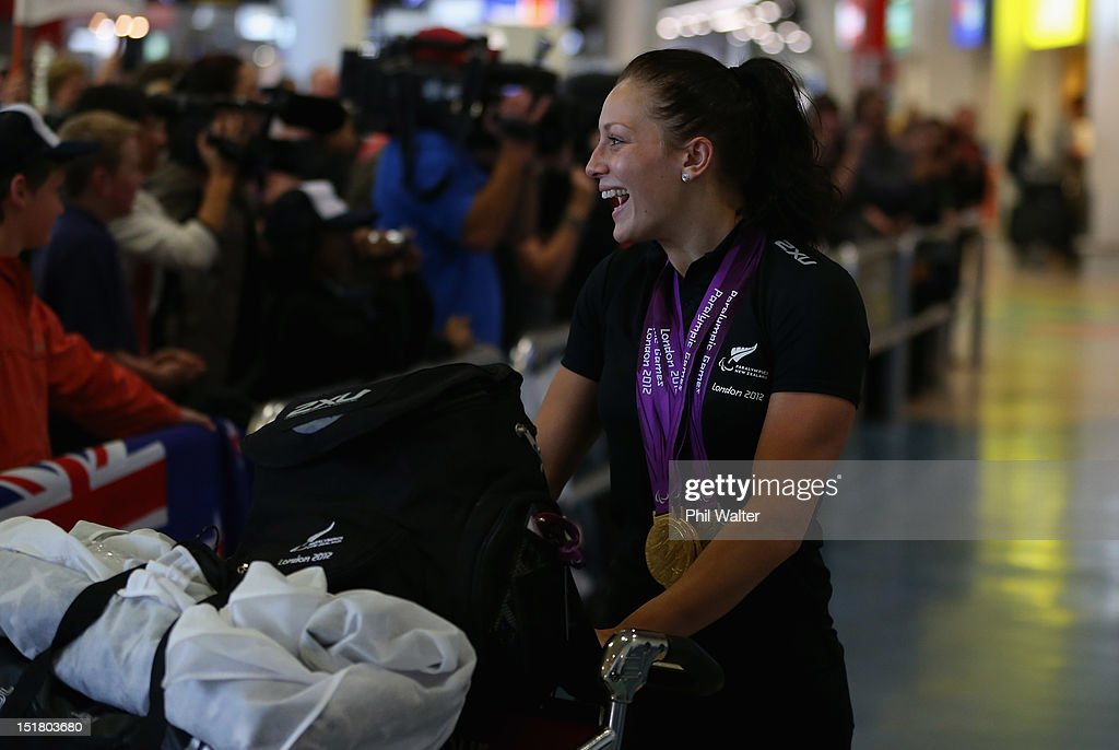 Sophie Pascoe arrives home with her haul of six medals from the London Paralympics, during the New Zealand Paralympians arrival home at Auckland International Airport on September 12, 2012 in Auckland, New Zealand.