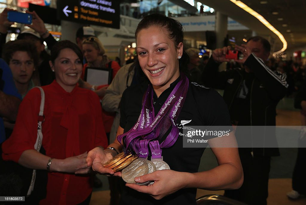 Sophie Pascoe holds her haul of six medals from the London Paralympics, during the New Zealand Paralympians arrival home at Auckland International Airport on September 12, 2012 in Auckland, New Zealand.