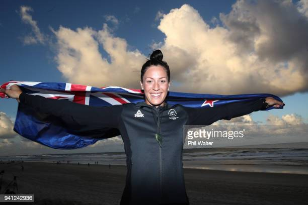 Sophie Pascoe of New Zealand poses with a New Zealand flag on the beach after being named as New Zealand's flag bearer for the 2018 Commonwealth...