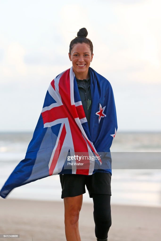 Sophie Pascoe of New Zealand poses with a New Zealand flag on the beach after being named as New Zealand's flag bearer for the 2018 Commonwealth Games on April 3, 2018 in Gold Coast, Australia.