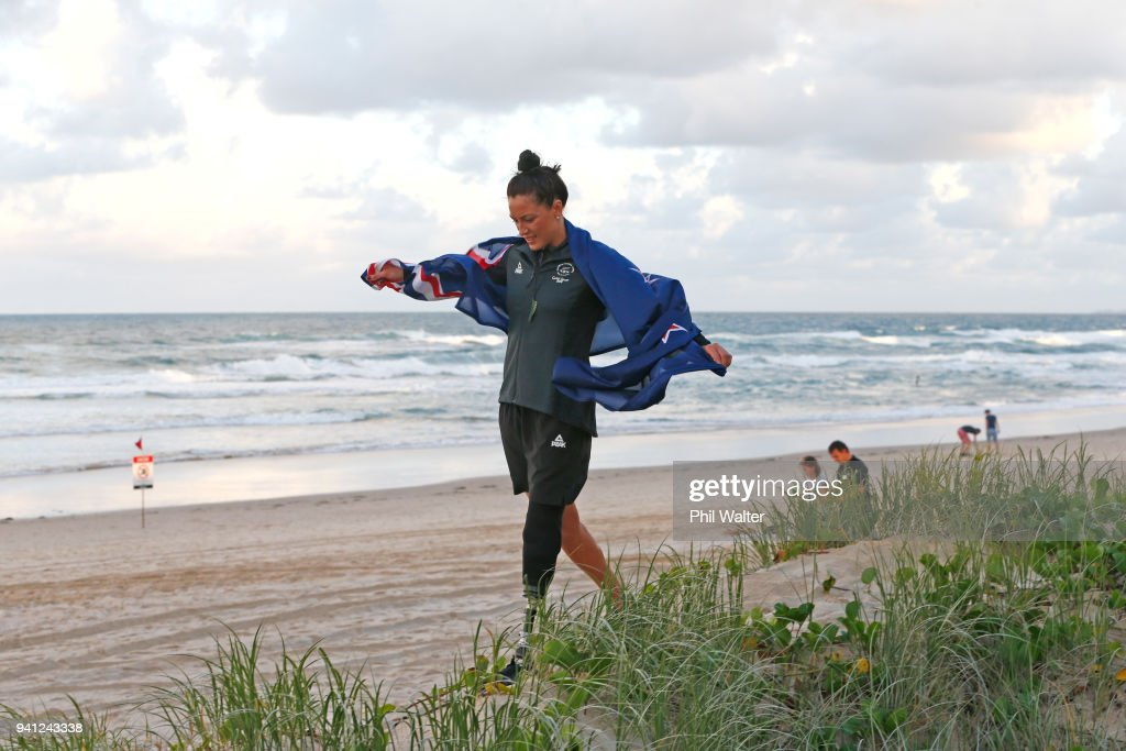 Sophie Pascoe of New Zealand walks with a New Zealand flag on the beach after being named as New Zealand's flag bearer for the 2018 Commonwealth Games on April 3, 2018 in Gold Coast, Australia.