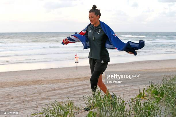 Sophie Pascoe of New Zealand walks with a New Zealand flag on the beach after being named as New Zealand's flag bearer for the 2018 Commonwealth...