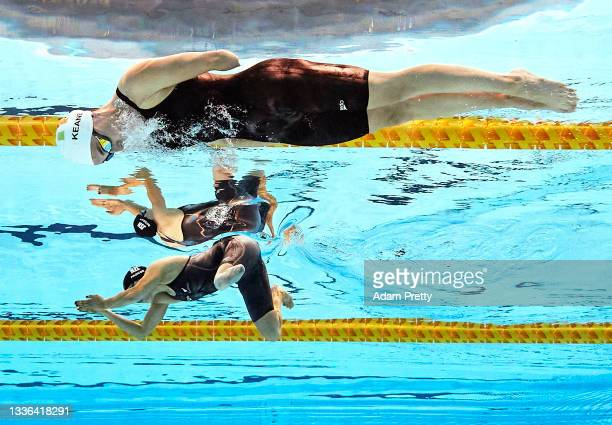 Sophie Pascoe of Team New Zealand and Ellen Keane of Team Ireland compete in their women's 100m breastroke - SB8 heat on day 2 of the Tokyo 2020...