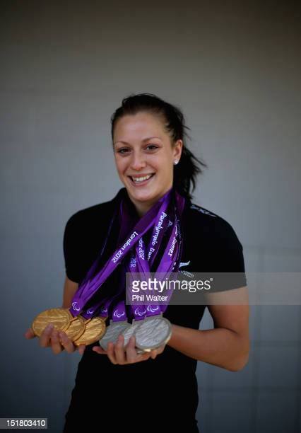 Sophie Pascoe poses for a portrait with her haul of six medals from the London Paralympics during the New Zealand Paralympians arrival home at...