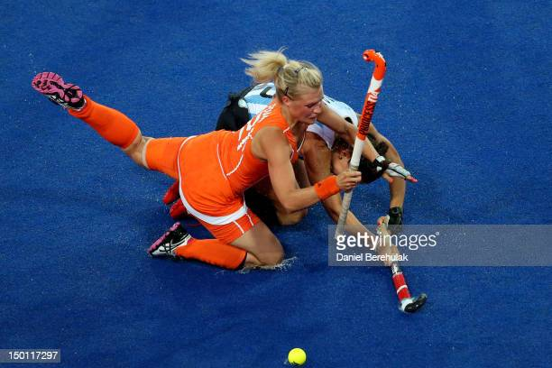 Sophie Polkamp of Netherlands collides with Sofia Maccari of Argentina during the first half of the Women's Hockey gold medal match on Day 14 of the...