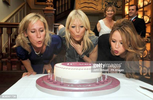 Sophie Raworth Gabby Roslin and Kimberley Walsh blow out the candles on a birthday cake during a Haven breast cancer charity 10th anniversary...
