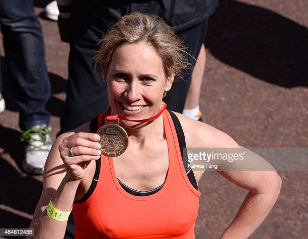 Sophie Raworth poses with her medal after completing the 2014 London Marathon on April 13 2014 in London England