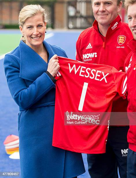 Sophie RhysJones Countess of Wessex is presented with an England Hockey shirt during a visit to the England hockey team at Bisham Abbey on March 11...