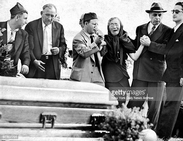 Sophie Rosenberg mother of executed spy Julius Rosenberg bursts into tears as caskets of her son and daughterinlaw Ethel are lowered into the earth...