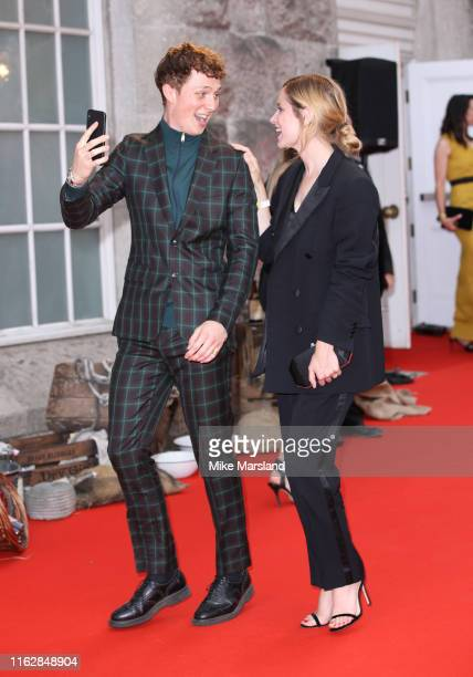 Sophie Rundle and Harry Kirton attend the premiere of the 5th season of Peaky Blinders at Birmingham Town Hall on July 18 2019 in Birmingham England