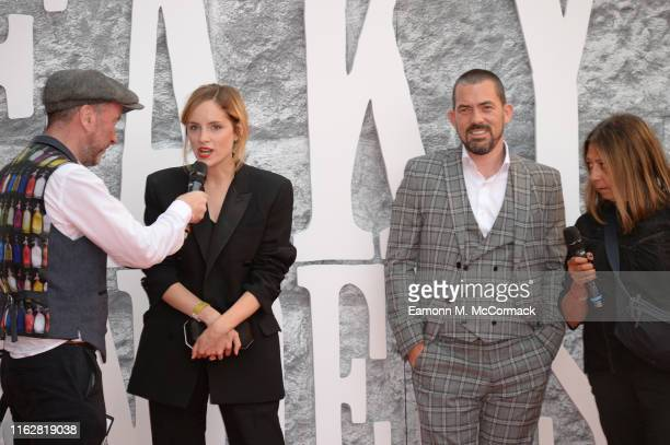 Sophie Rundle and Packy Lee are interviewed during the premiere of the 5th season of Peaky Blinders at Birmingham Town Hall on July 18 2019 in...