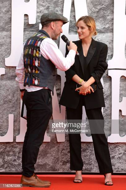 Sophie Rundle is interviewed during the premiere of the 5th season of Peaky Blinders at Birmingham Town Hall on July 18 2019 in Birmingham England