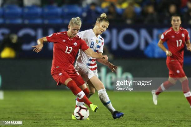 Sophie Schmidt of Canada and Julie Ertz of United States fight for the ball during a match between Canada and United States as part of CONCACAF...