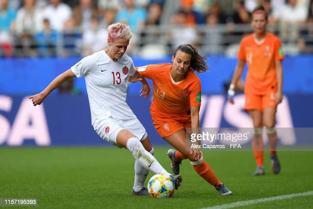 Sophie Schmidt of Canada battles for possession with Renate Jansen of the Netherlands during the 2019 FIFA Women's World Cup France group E match...
