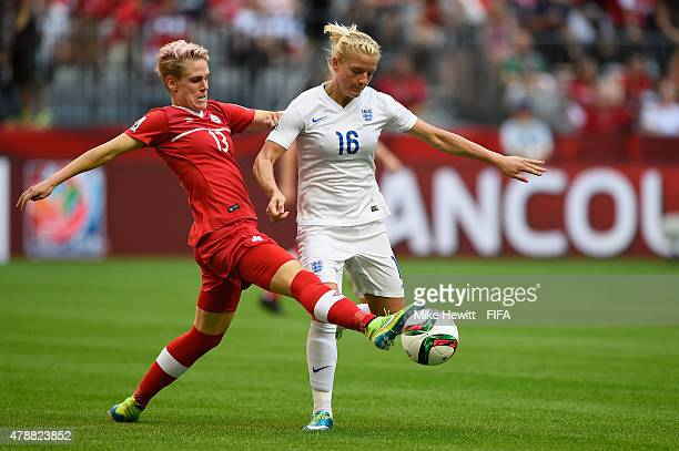 Sophie Schmidt of Canada challenges Toni Duggan of England during the FIFA Women's World Cup 2015 Quarter Final match between England and Canada at...