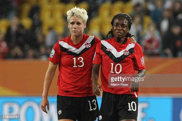 Sophie Schmidt of Canada comforts team mate Jodi Ann Robinson after the FIFA Women's World Cup 2011 Group A match between Canada and Nigeria at...