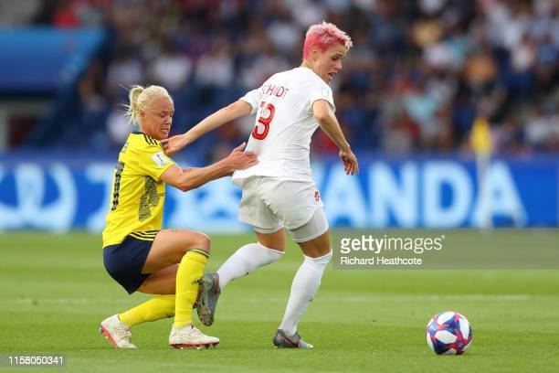 Sophie Schmidt of Canada is challenged by Caroline Seger of Sweden during the 2019 FIFA Women's World Cup France Round Of 16 match between Sweden and...