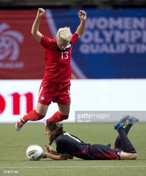 Sophie Schmidt of Canada jumps over a sliding Jenifer Ruiz of Mexico during the first half of semifinals action of the 2012 CONCACAF Women's Olympic...