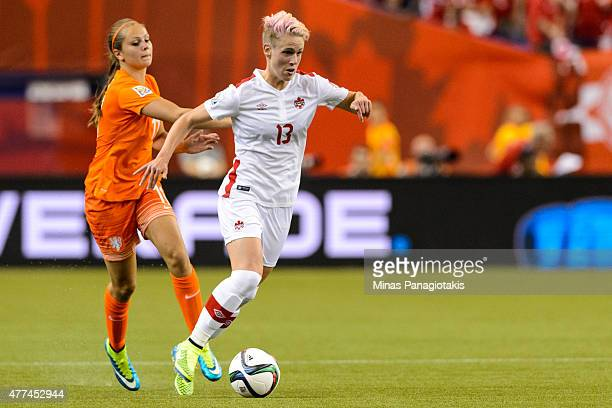 Sophie Schmidt of Canada moves the ball past Lieke Martens of the Netherlands during the 2015 FIFA Women's World Cup Group A match at Olympic Stadium...