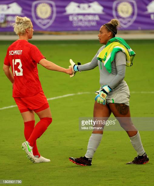 Sophie Schmidt of Canada shakes hands with Barbara of Brazil during the SheBelieves Cup at Exploria Stadium on February 24, 2021 in Orlando, Florida.