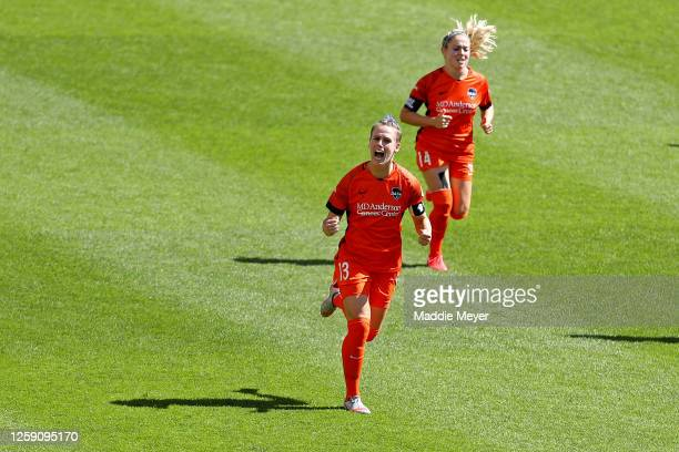 Sophie Schmidt of Houston Dash celebrates after scoring a penalty kick in the 5th minute against Alyssa Naeher of Chicago Red Stars during the first...